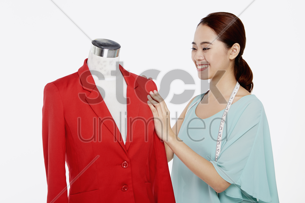 woman checking the jacket sleeve stock photo