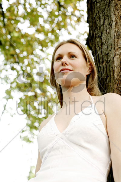 woman contemplating in the park stock photo