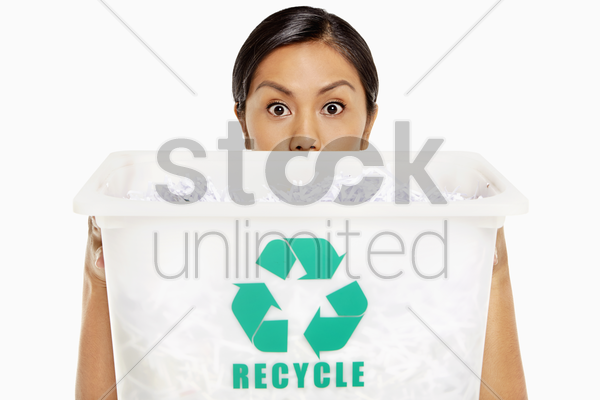 woman covering half her face with a plastic box stock photo
