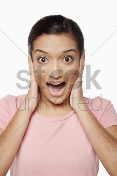 woman covering her ears with hands stock photo