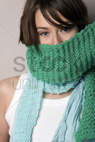 woman covering her mouth with a scarf stock photo