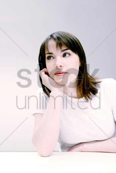 woman daydreaming in the classroom stock photo