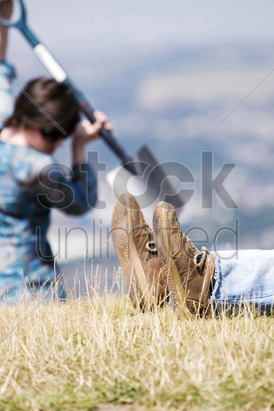 woman digging hole with a dead body beside her stock photo