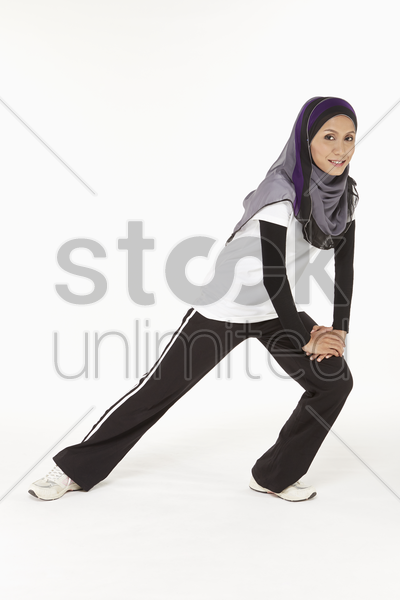 woman doing lunges, facing left stock photo