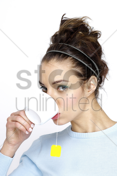 woman drinking a cup of tea stock photo