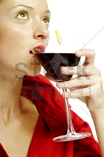 woman drinking a glass of red wine stock photo