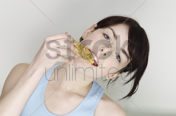 woman eating biscuit stock photo