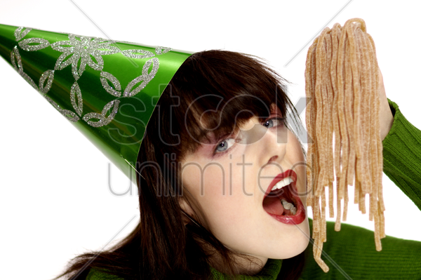 woman eating candy stock photo