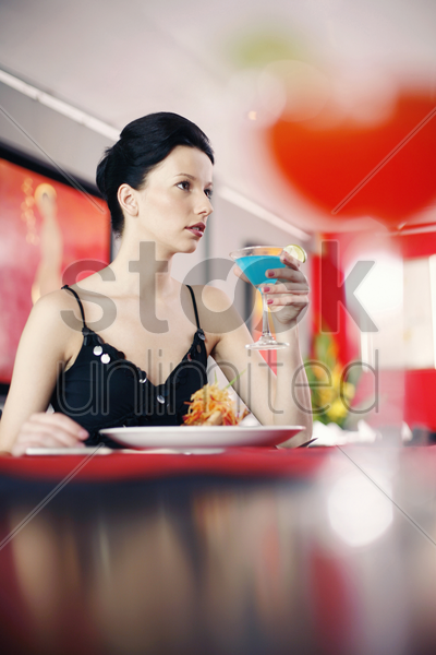 woman eating in a restaurant stock photo