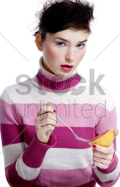 woman eating orange stock photo
