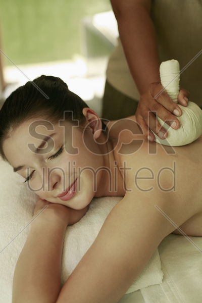 woman enjoying a back massage stock photo