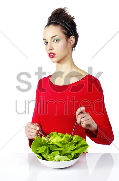 woman enjoying a bowl of vegetables stock photo