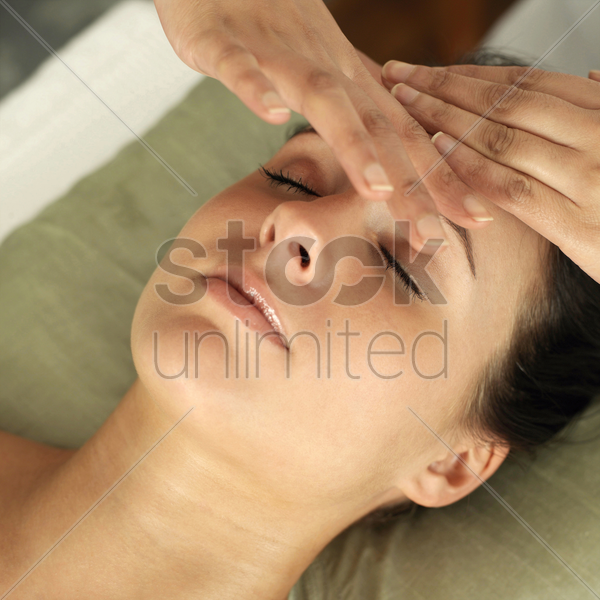 woman enjoying a head massage stock photo