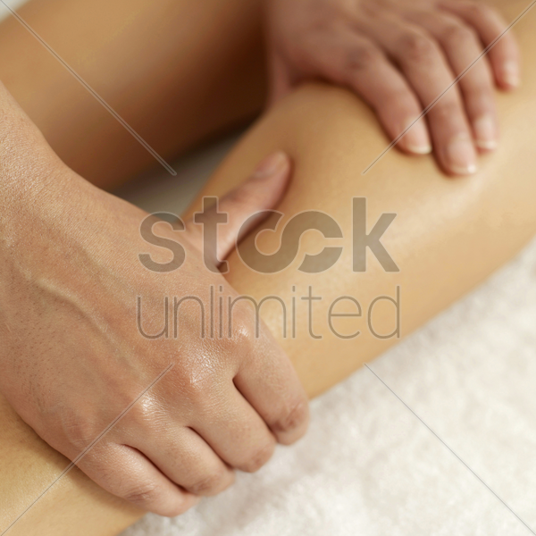 woman enjoying a leg massage stock photo