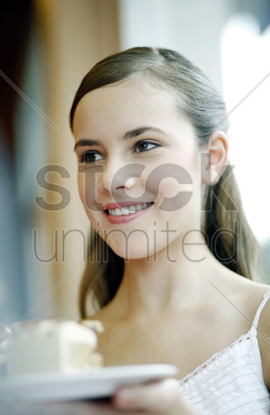woman enjoying a piece of cake in the cafe stock photo