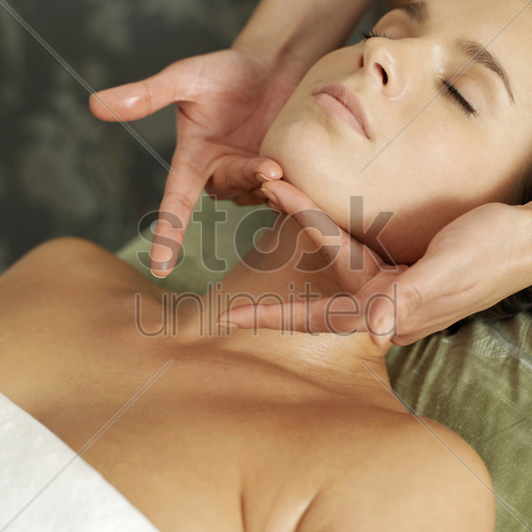 woman enjoying a relaxing body massage stock photo