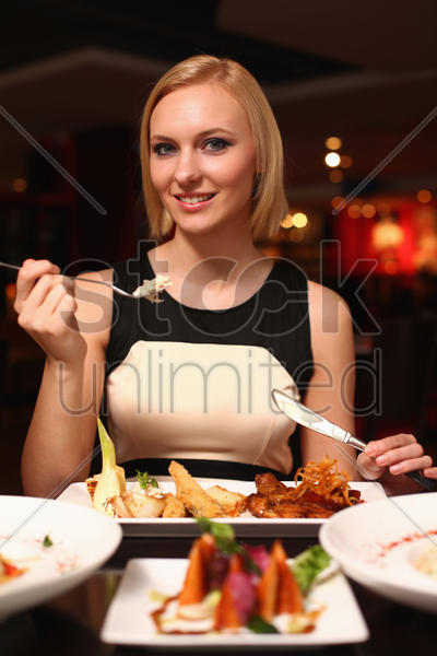 woman enjoying her meal stock photo