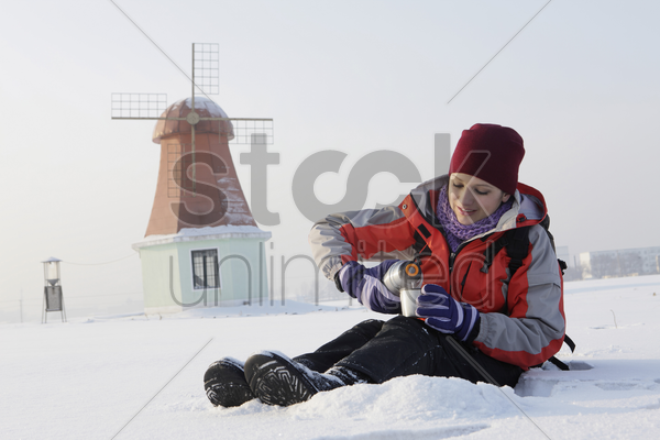 woman enjoying hot drink on winter day stock photo
