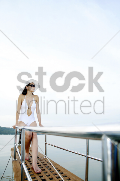 woman enjoying sea view from the rear of a boat stock photo