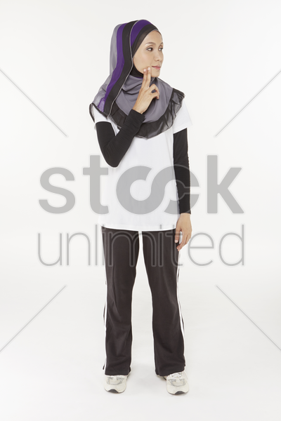 woman exercising and stretching, facing left stock photo