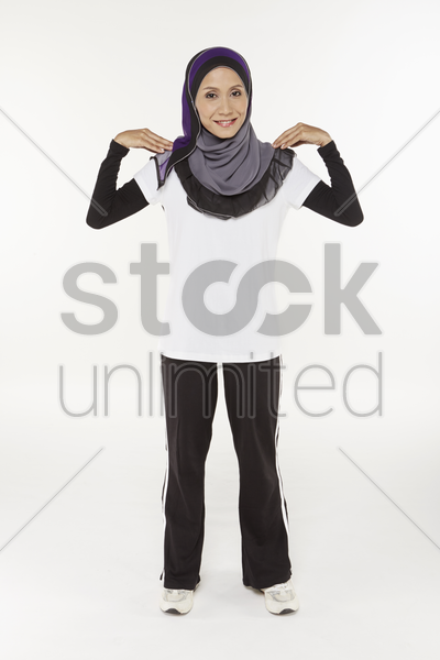 woman exercising her shoulders stock photo