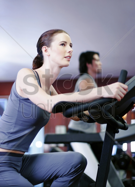 woman exercising in a gym stock photo