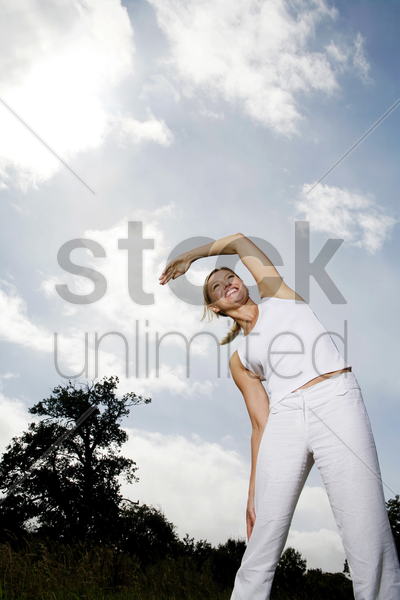 woman exercising in the park stock photo