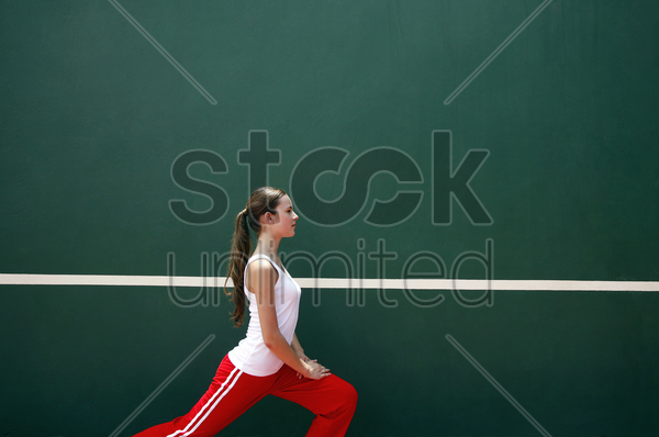 woman exercising in the tennis court stock photo