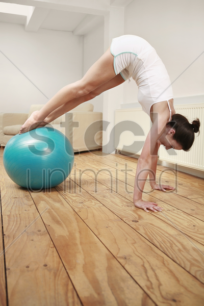 woman exercising with fitness ball stock photo