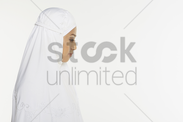 woman facing the qiblah with the intention of performing prayer stock photo