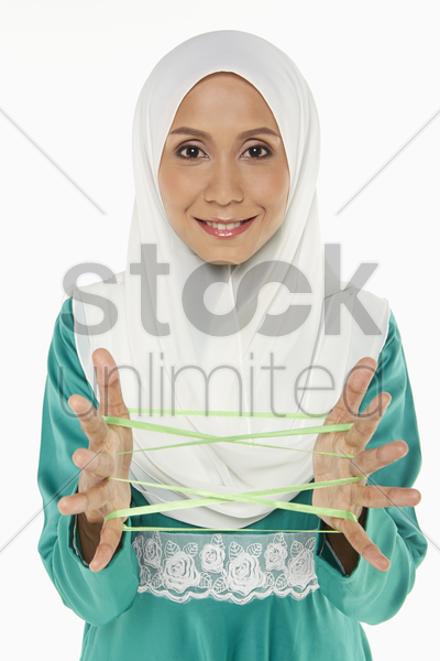 woman forming a cat's cradle stock photo