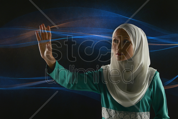 woman gesturing against abstract background stock photo