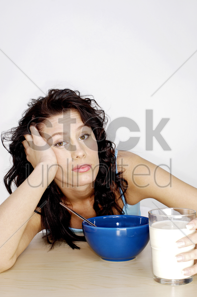 woman getting bored with her breakfast stock photo