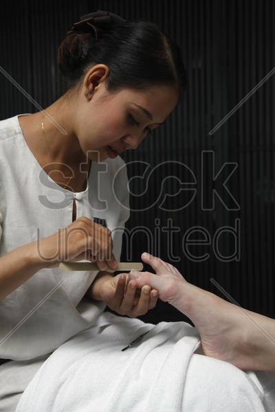 woman giving pedicure stock photo