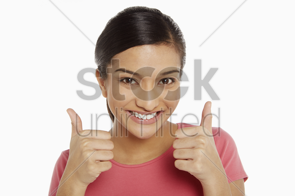 woman giving two thumbs up stock photo
