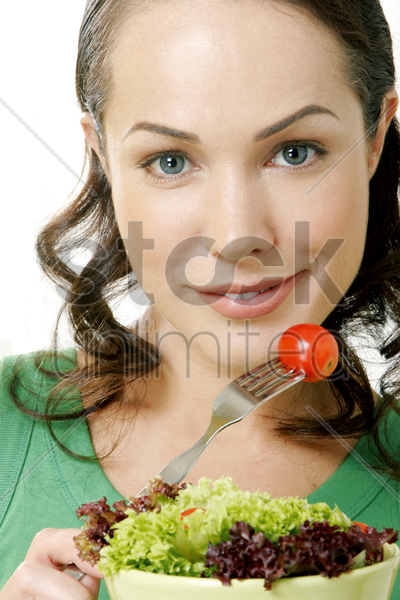 woman having a bowl of salad stock photo