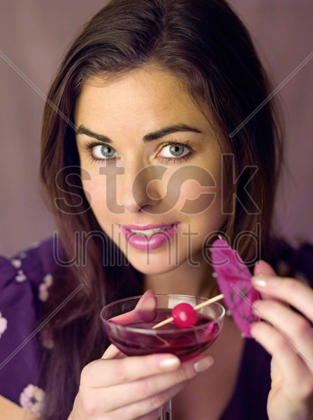 woman having a cocktail drink stock photo