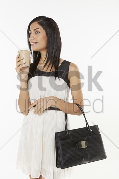woman having a drink stock photo