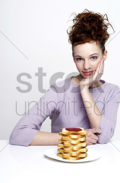 woman having bread with jam stock photo