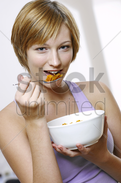 woman having breakfast cereal stock photo