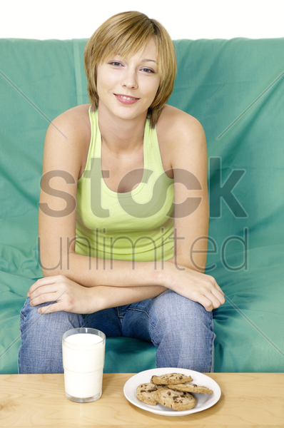 woman having cookies and milk for breakfast stock photo