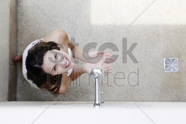 woman having shower in the bathroom stock photo