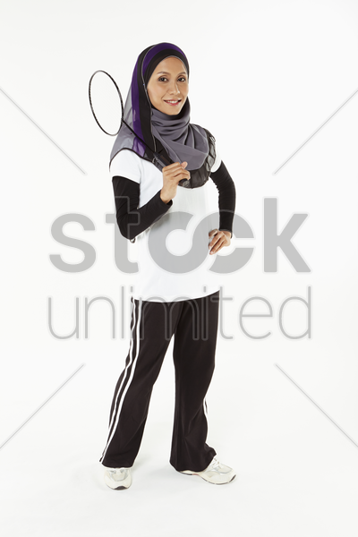 woman holding a badminton racket stock photo