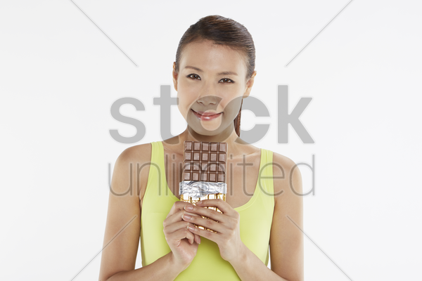 woman holding a bar of chocolate stock photo