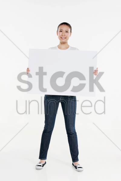 woman holding a big white placard stock photo