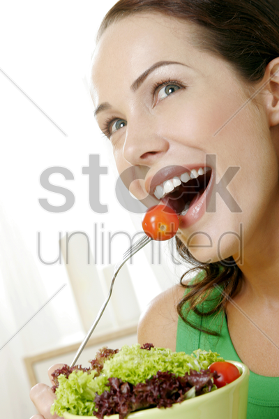 woman holding a bowl of salad stock photo