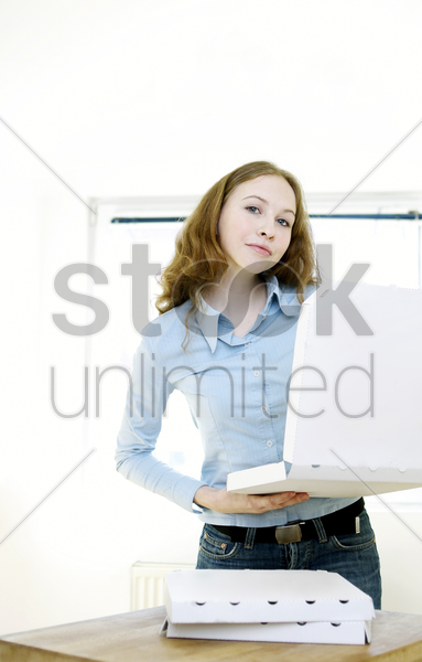 woman holding a box of pizza stock photo