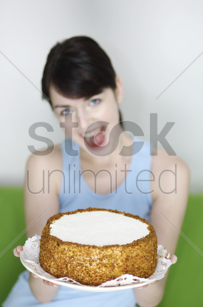 woman holding a cake stock photo