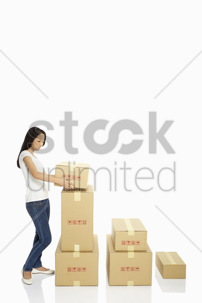 woman holding a cardboard box stock photo