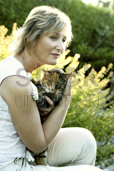 woman holding a cat stock photo